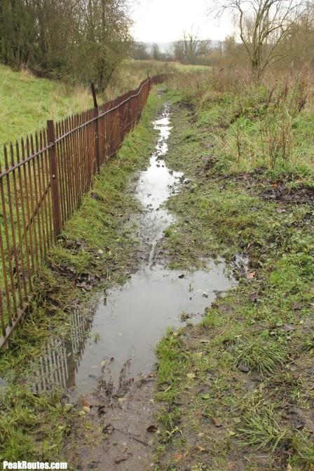 Waterlogged footpath beside the River Wye