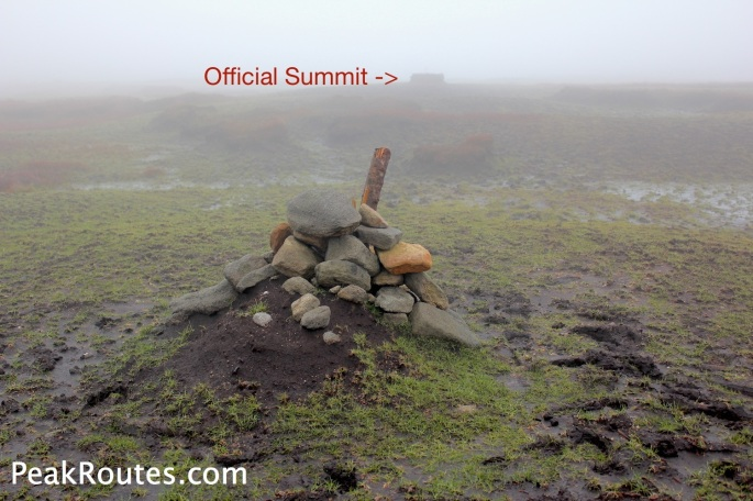 Official Summit area, the false cairn is pictured with the Official Grass mound summit in the background