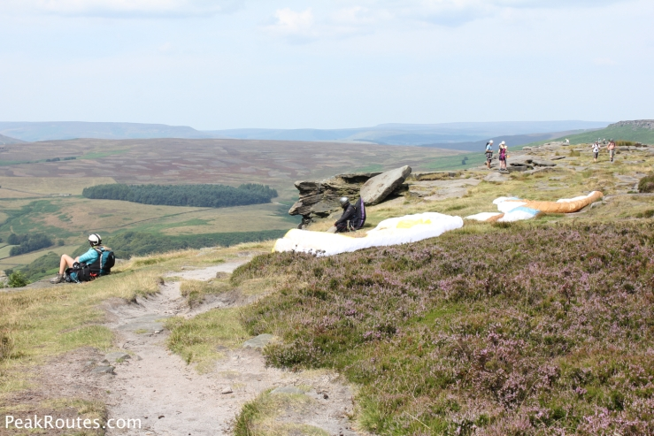 Paragliders awaiting optimum conditions on Stanage Edge